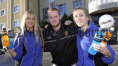 Down GAA star Benny Coulter gives his full support to the Powerade girls from Coca Cola (Ulster) Ltd who announced that Powerade is the official sports drink for all county teams within Down for the next three years.                  Picture: Traolach Hollywood