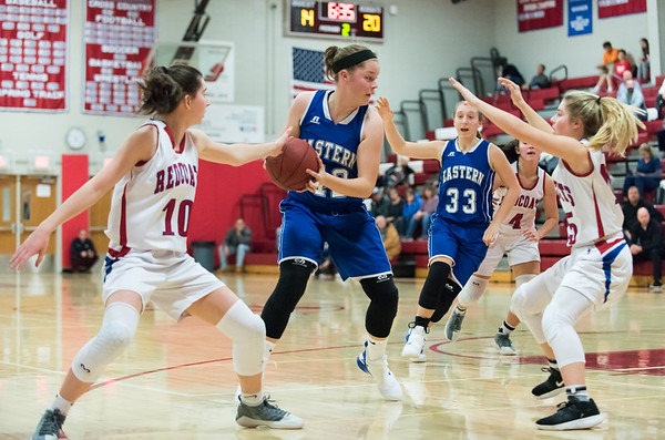 12/17/18 Wesley Bunnell | Staff Berlin basketball vs Bristol Eastern at Berlin High School on Monday evening. Ashley Wenzel (10) and Carly Grega (15) guard Avery Arbuckle (42).
