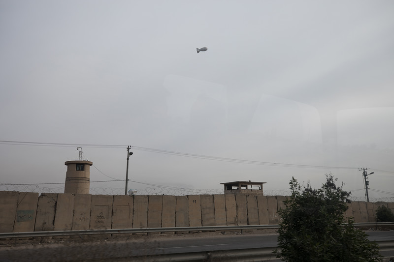 A spy surveillance balloon tethered above a military base, Baghdad.