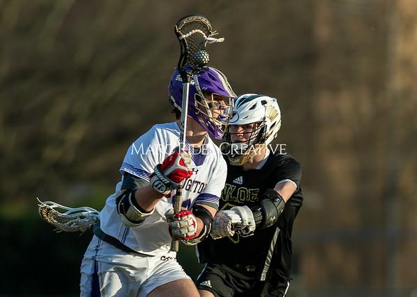 Broughton boys varsity lacrosse vs Enloe. March 10, 2020. D4S_8041