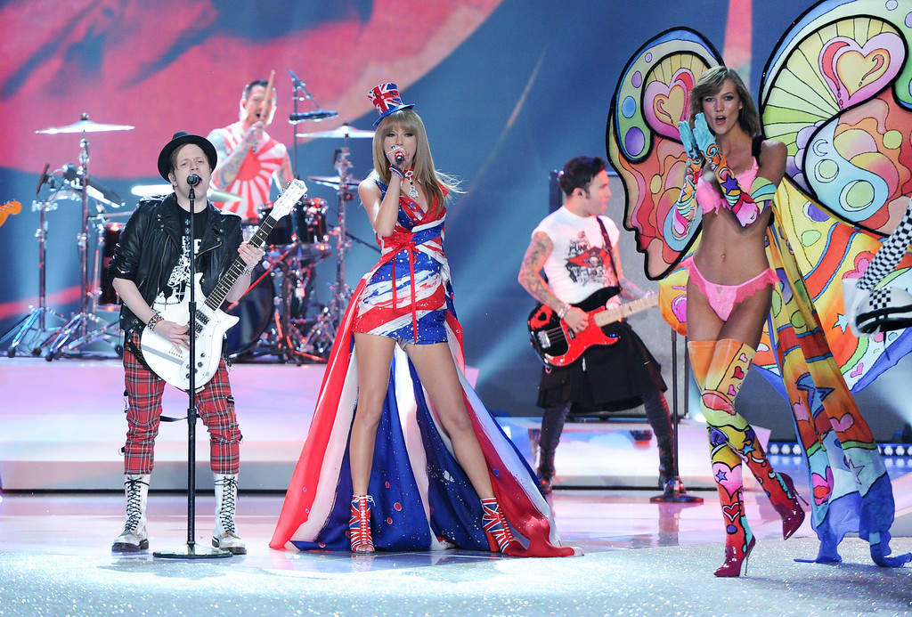 . Singer Taylor Swift, center, performs with Fall Out Boy during the 2013 Victoria\'s Secret Fashion Show at the 69th Regiment Armory on Wednesday, Nov. 13, 2013, in New York. (Photo by Evan Agostini/Invision/AP)