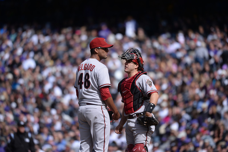 . Diamondbacks pitcher Randall Delgado (48) talks with Miguel Montero (26) during the third inning. The Colorado Rockies hosted the Arizona Diamondbacks in the Rockies season home opener at Coors Field in Denver, Colorado Friday, April 4, 2014. (Photo by Karl Gehring/The Denver Post)