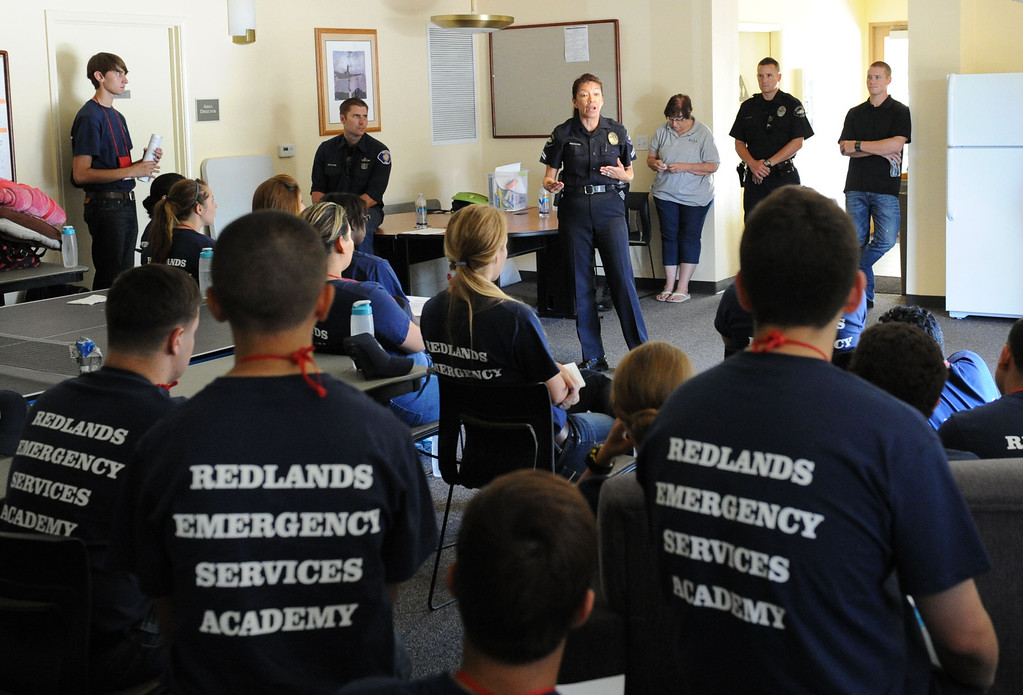 . (John Valenzuela/ Staff Photographer) Redlands Police Corporal Cindy Gourlay talks with Redlands Emergency Services Academy (R.E.S.A) students during orientation at the University Redlands, July 17, 2013. The annual academy, which has twenty participating this year, takes high school grads on a week long course to see if they have what it takes to have a career in public safety. RESA is taught by area firefighters and police officers.