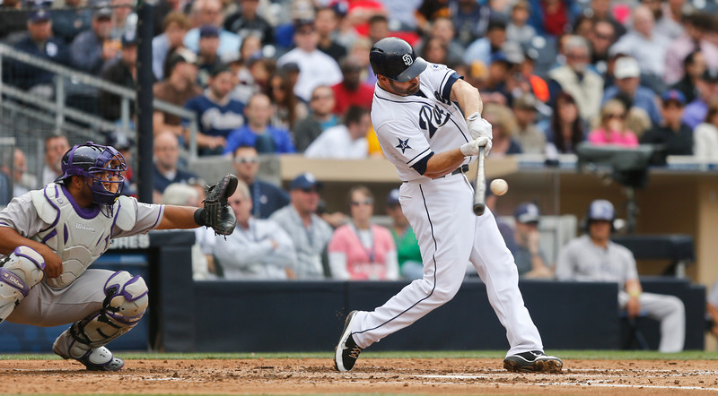 . San Diego Padres\' Xavier Nady connects for a solo home run against the Colorado Rockies to break a scoreless tie in the fourth of a baseball game Thursday, April 17, 2014, in San Diego. The Rockies catcher is Wilin Rosario. (AP Photo/Lenny Ignelzi)