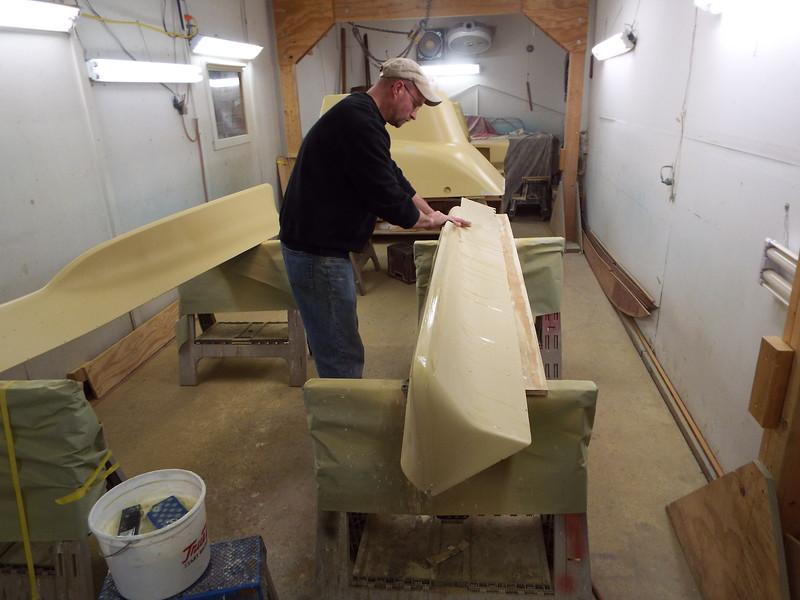 Wet sanding the final coat of primer.