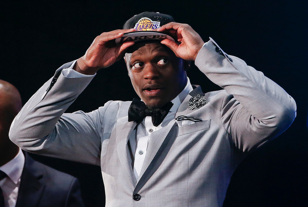 . Kentucky forward Julius Randle dons a Los Angeles Lakers cap after being selected seventh overall by the Lakers during the 2014 NBA draft, Thursday, June 26, 2014, in New York.  (AP Photo/Jason DeCrow)