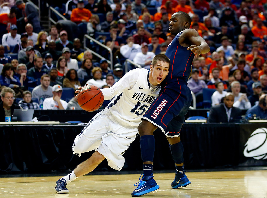 . BUFFALO, NY - MARCH 22: Ryan Arcidiacono #15 of the Villanova Wildcats drives to the basket as Terrence Samuel #3 of the Connecticut Huskies defends during the third round of the 2014 NCAA Men\'s Basketball Tournament at the First Niagara Center on March 22, 2014 in Buffalo, New York.  (Photo by Jared Wickerham/Getty Images)