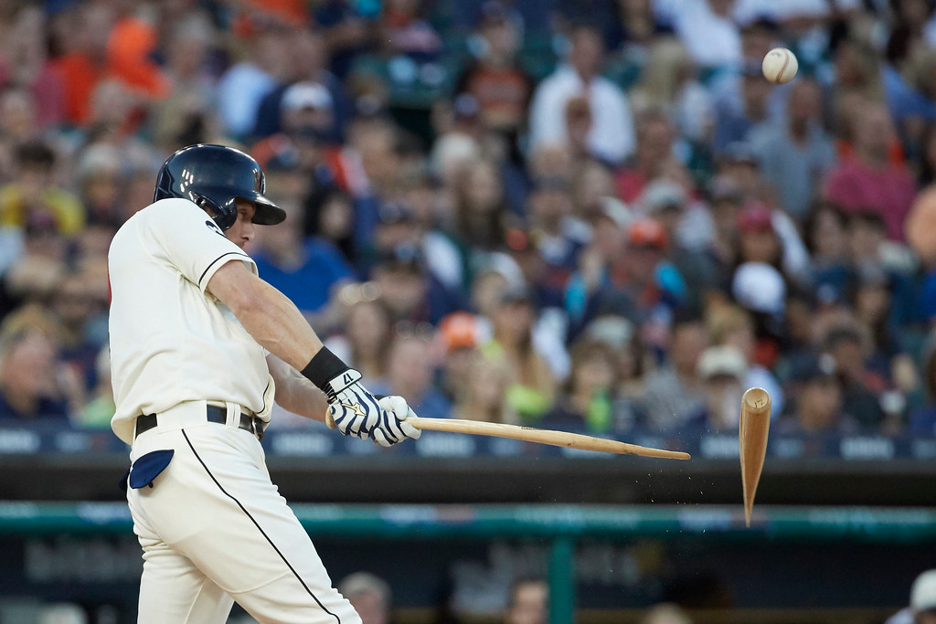 . Detroit Tigers Andrew Romine breaks his bat on a foul ball during the fourth inning against the Cleveland Indians in the second baseball game of a doubleheader in Detroit, Saturday, July 1, 2017. (AP Photo/Rick Osentoski)