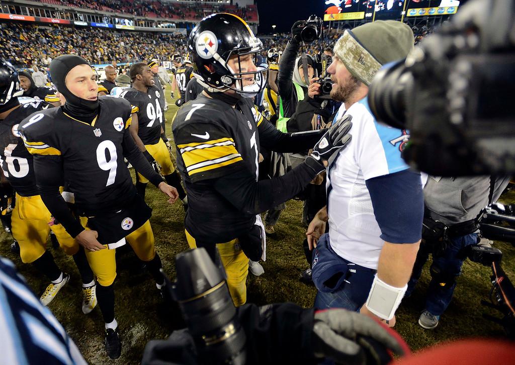 . Pittsburgh Steelers quarterback Ben Roethlisberger (7) talks with Tennessee Titans quarterback Zach Mettenberger, right, after an NFL football game Monday, Nov. 17, 2014, in Nashville, Tenn. The Steelers won 27-24. (AP Photo/Mark Zaleski)