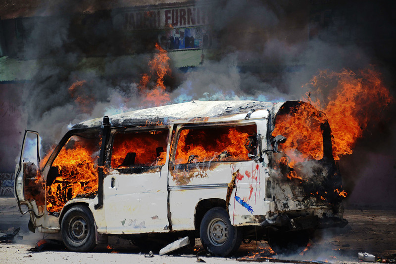 . A mini bus catches fire at the site of a car bomb in central Mogadishu on March 18, 2013. The attack is the worst in Mogadishu since September 2012, when two suicide bombers killed 18 people in a restaurant.  Mohamed Abdiwahab/AFP/Getty Images