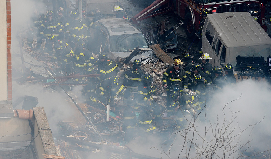 . A view of firefighters on the scene where a group of buildings were damaged nu an explosion in New York, New York, USA, 12 March 2014.  EPA/JUSTIN LANE