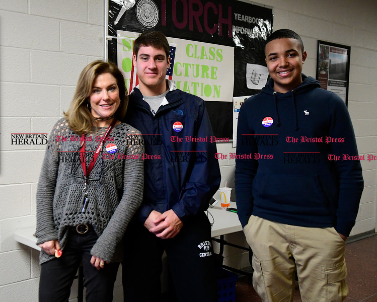 11/1/2016 Mike Orazzi | Staff Bristol Central voters Marla Pechulis, Alex Lape and Jayce Antrum in the hallway after the mock election held at Bristol Central High School Tuesday.