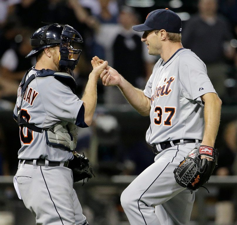 . Detroit Tigers starter Max Scherzer, right, celebrates with catcher Bryan Holaday after they defeated the Chicago White Sox 4-0 in a baseball game in Chicago, Thursday, June 12, 2014. (AP Photo/Nam Y. Huh)