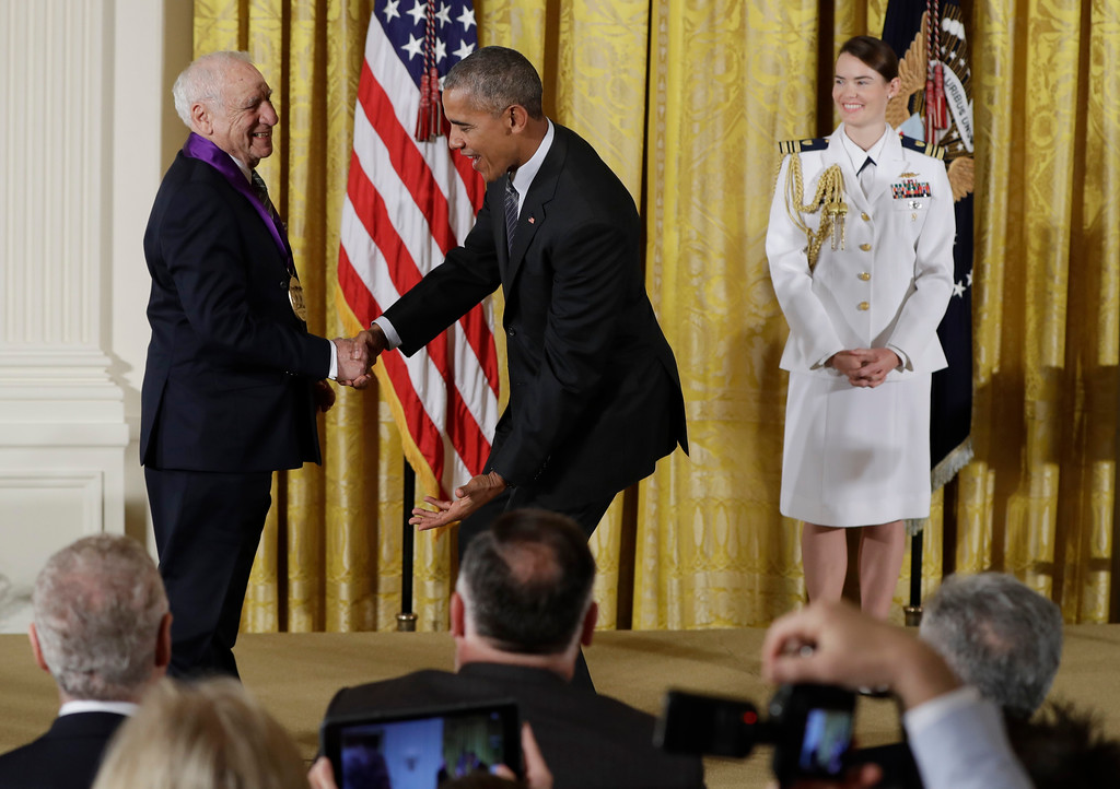 . President Barack Obama jokes with actor, comedian and writer, Mel Brooks, as he awards him the 2015 National Medal of Arts during a ceremony in the East Room of the White House, Thursday, Sept. 22, 2016, in Washington. (AP Photo/Carolyn Kaster)