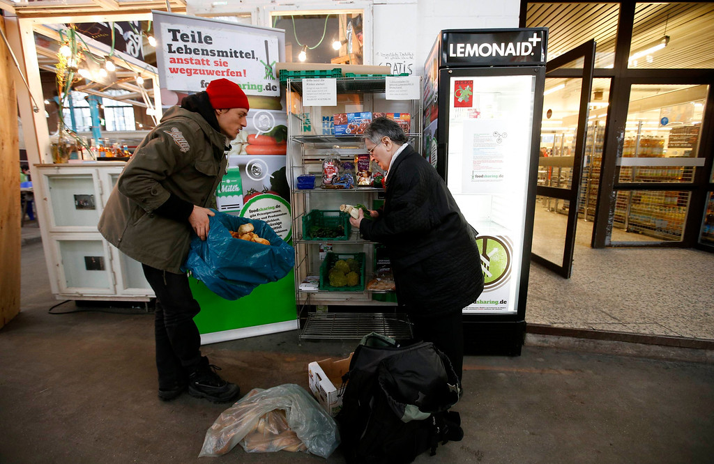 . Raphael Fellmer, a supporter of the foodsharing movement brings food sorted out from waste bins of an organic supermarket to a distribution point at the indoor market Markthalle Neun (indoor market nine) in Berlin, January 31, 2013. Foodsharing is a German internet based platform where individuals, retailers or producers have the possibility of offering surplus food to consumers for free. REUTERS/Fabrizio Bensch