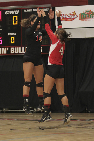 Dominique Bray (14) and Anna Pashkova (4) get pumped before the game