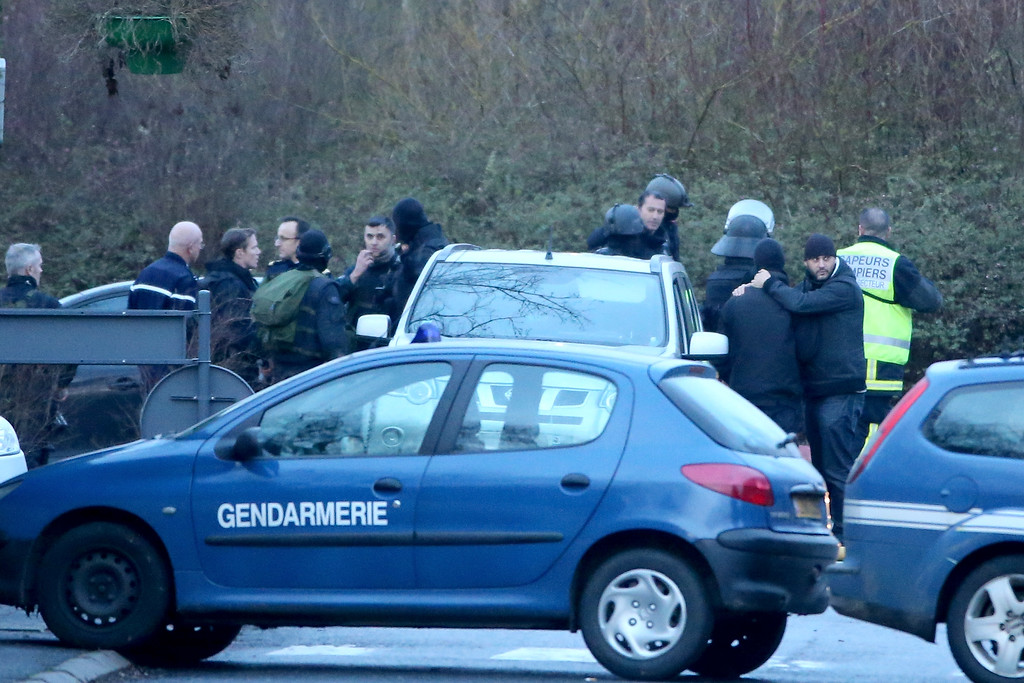 . Special Forces soldiers and armed police gather after storming a building on an industrial estate where it is thought the suspects linked to the Charlie Hebdo massacre are holding a hostage on January 9, 2015 in Dammartin en Goele, France. A huge manhunt for the two suspected gunmen in Wednesday\'s deadly attack on Charlie Hebdo magazine has entered its third day with major police activity surrounding the village of Dammartin en Goele where the suspects are holed up.  (Photo by Christopher Furlong/Getty Images)