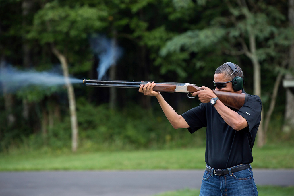 . U.S. President Barack Obama shoots clay targets with a shotgun on the range at Camp David, Maryland, in this White House handout photo taken August 4, 2012.  REUTERS/White House/Pete Souza/Handout