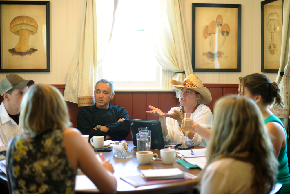. Summer Love series with Lenny, center and Sara Martinelli  (back right) have a staff meeting at the shoot at the  Chautauqua Dining Hall. The couple runs several restaurants in Boulder including the dining hall.  (Photo By Cyrus McCrimmon/The Denver Post)
