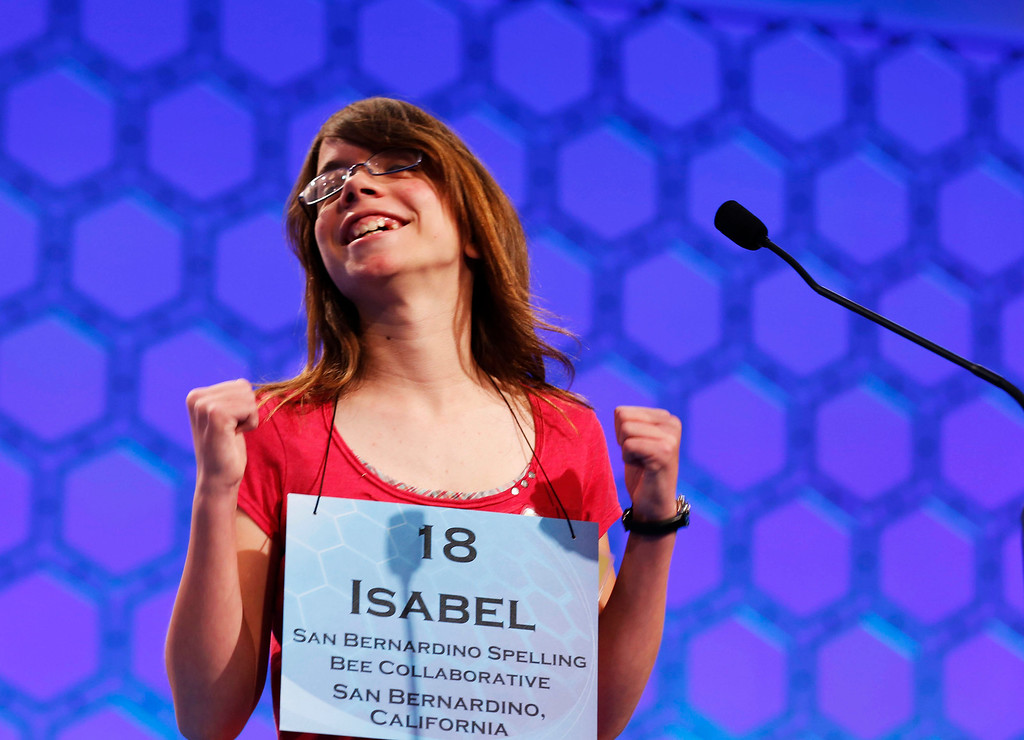 . California student Isabel Cholbi of San Bernardino, reacts after spelling correctly in the semi-final round of the 2013 Scripps National Spelling Bee at the Gaylord National Resort and Convention Center at National Harbor in Maryland, May 30, 2013.     REUTERS/Larry Downing