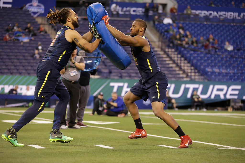 . Alabama tight end O.J. Howard, right, blocks Virginia Tech tight end Bucky Hodges as they run a drill at the NFL football scouting combine in Indianapolis, Saturday, March 4, 2017. (AP Photo/Michael Conroy)