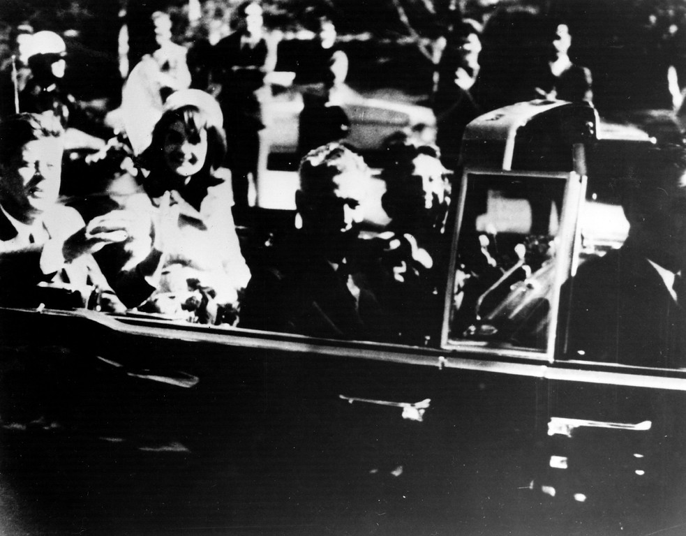 . The president waves to the crowds shortly before gunfire rang out. Keystone/Getty Images