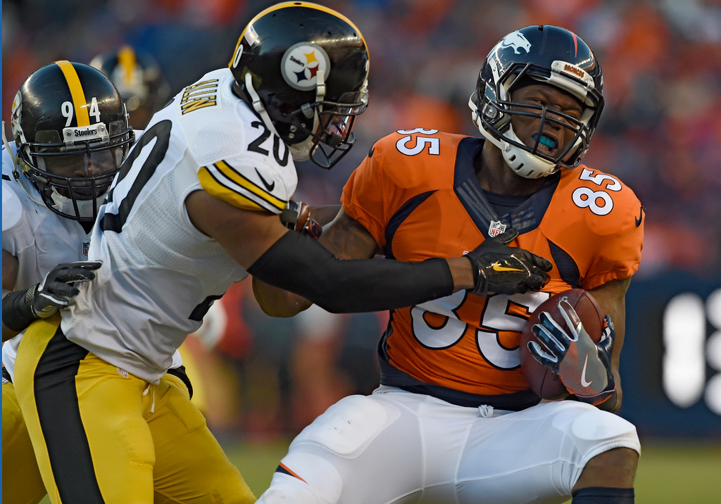 . Denver Broncos tight end Virgil Green (85) tries to break away from Pittsburgh Steelers strong safety Will Allen (20) during the third quarter January 17, 2016 in the Divisional Round Playoff game at Sports Authority Field at Mile High Stadium. (Photo By Helen Richardson/The Denver Post)