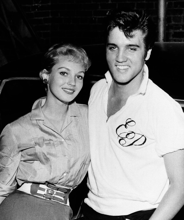 . Elvis Presley, right, poses with actress Venetia Stevenson in Memphis, Aug. 9, 1957. (AP Photo)