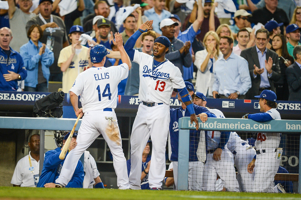 . Dodgers\' Mark Ellis is congratulated by Hanley Ramirez after he scored in game 3 of the NLCS Monday October 14, 2013 ( Photo by Hans Gutknecht/Los Angeles Daily News )