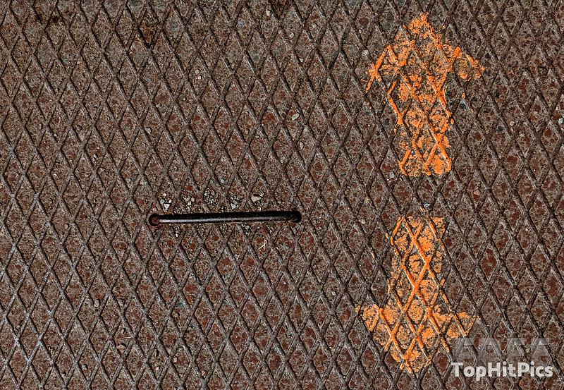 Arrows On A Metal Grid