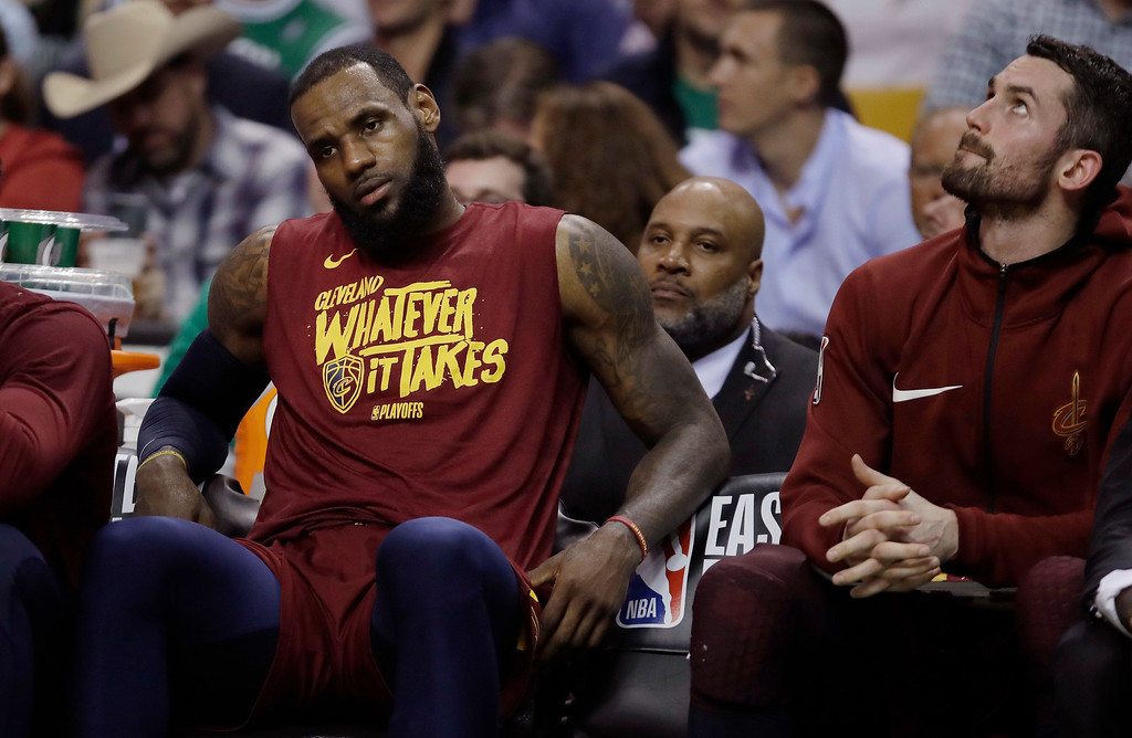 . Cleveland Cavaliers forward LeBron James, left, and center Kevin Love sit on the bench during the second half in Game 2 of the team\'s NBA basketball Eastern Conference finals against the Boston Celtics, Tuesday, May 15, 2018, in Boston. (AP Photo/Charles Krupa)