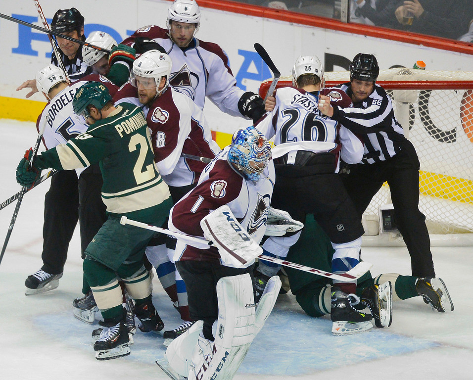 . Officials tried to pull players apart following a save by Colorado goalie Semyon Varlamov in the second period.   (Photo by Karl Gehring/The Denver Post)