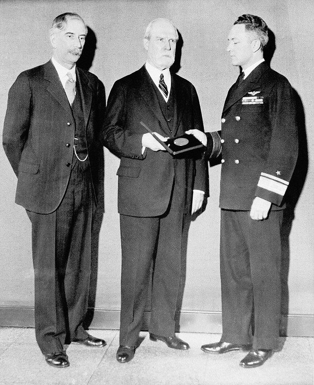 . As chancellor of the Smithsonian Institution in Washington, D.C., Chief justice Charles Evans Hughes on March 27, 1931 presented Rear Admiral Richard E. Byrd the Langley Medal for Aeronautics, in recognition of his flights over the North and South Poles, and his Trans-Atlantic Flight. Left to right: Dr, Charles G. Abbott, Secretary of the Smithsonian, Chief Justice Hughes and Rear Admiral Byrd. (AP Photo)