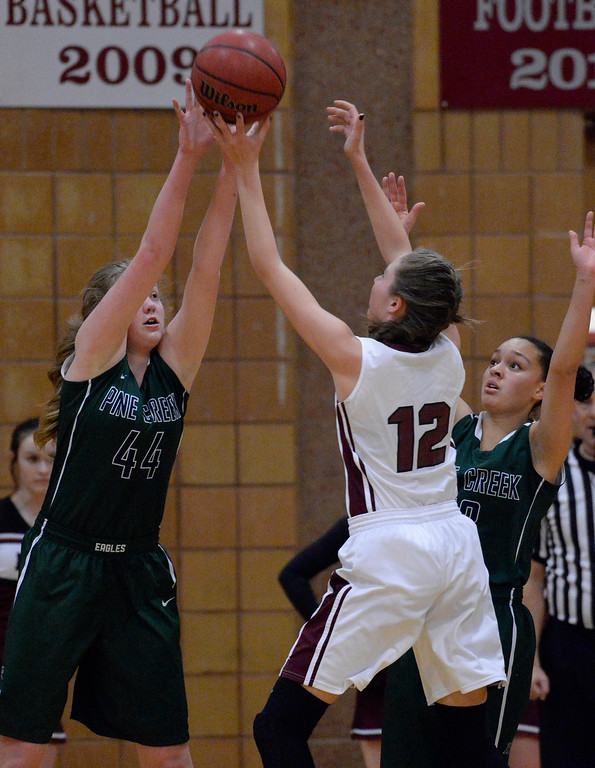. THORNTON, CO - MARCH 01: Horizon Alyssa Jimenez (12) gets her shot blocked by Pine Creek Courtney Stanton (44) during the second quarter in the Girls Class 5A Sweet 16 game March 1, 2016 at Horizon HS. (Photo By John Leyba/The Denver Post)