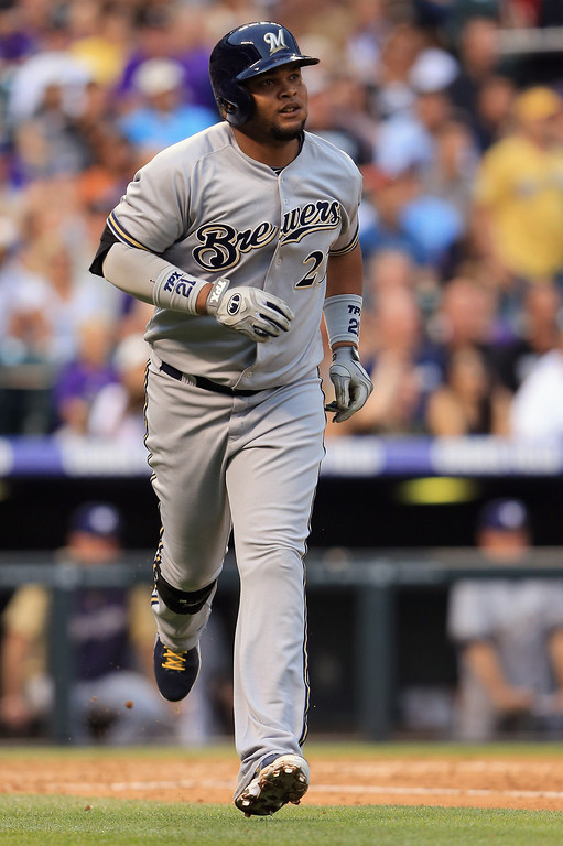 . DENVER, CO - JULY 27:  Juan Francisco #21 of the Milwaukee Brewers rounds the bases on his two run home run off of starting pitcher Collin McHugh #43 of the Colorado Rockies in the third inning at Coors Field on July 27, 2013 in Denver, Colorado.  (Photo by Doug Pensinger/Getty Images)