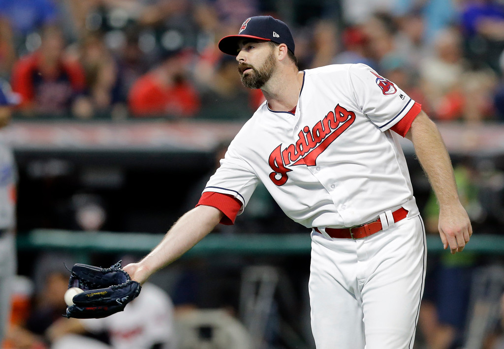 . Cleveland Indians relief pitcher Boone Logan gets another ball as he waits for Los Angeles Dodgers\' Cody Bellinger to run the bases after Bellinger hit a three-run home run in the ninth inning of an interleague baseball game, Tuesday, June 13, 2017, in Cleveland. (AP Photo/Tony Dejak)