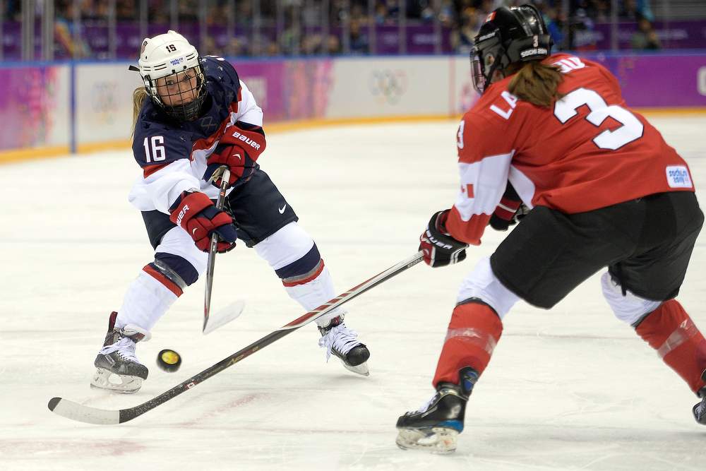 . Kelli Stack (16) of the U.S.A. shoots as Jocelyne Larocque (3) of the Canada defends during the first period of the women\'s gold medal ice hockey game. Sochi 2014 Winter Olympics on Thursday, February 20, 2014 at Bolshoy Ice Arena. (Photo by AAron Ontiveroz/ The Denver Post)