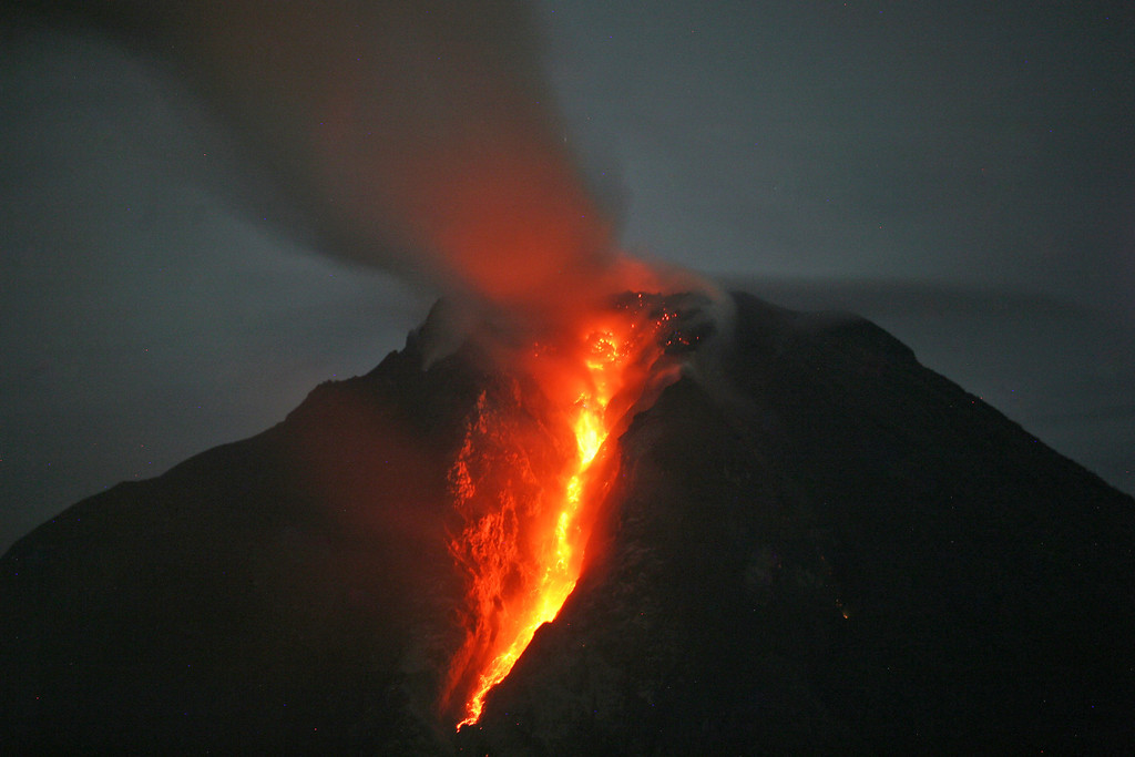 . Mount Sinabung spews hot lava as seen from Jeraya, North Sumatra, Indonesia. The 2,600-meter (8,530-foot) volcano has sporadically erupted since September. Authorities extended a danger zone around a rumbling volcano in western Indonesia on Sunday after it spewed blistering gas farther than expected, sending panicked residents streaming down the sides of the mountain. (AP Photo/Binsar Bakkara)