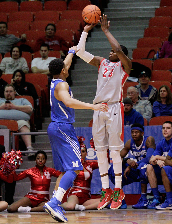. Houston\'s forward Danuel House (23) shoots a three-point shot against Memphis during the first half of an NCAA college basketball game, Thursday, Feb. 27, 2014, in Houston. (AP Photo/Bob Levey)