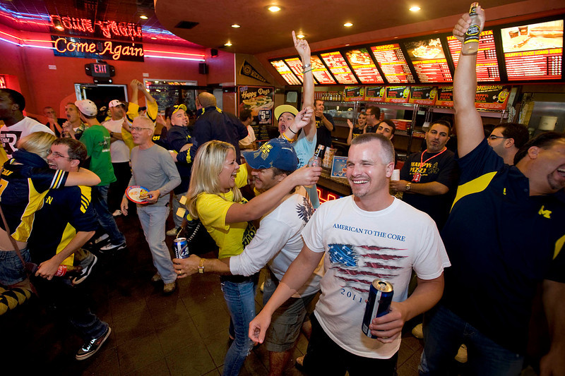 Fans celebrate at Happy's Pizza on Main Streert as Michigan scores the winning touchdown during U-M's first-ever night game on Sept 10, 2011.