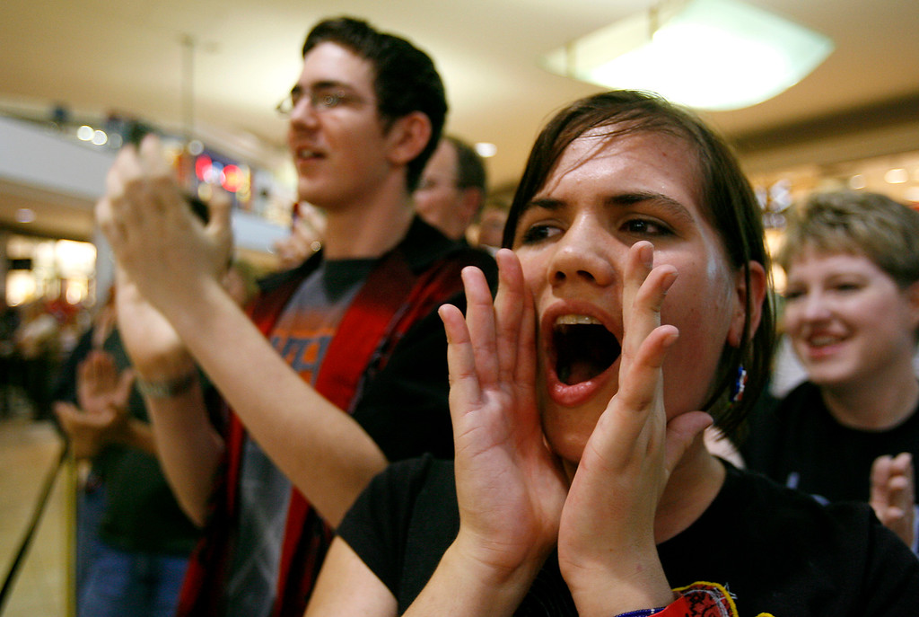 """. Sierra Pratt, 14, right, and Seth Howland, 15, chant \""""iPhone, iphone\"""" about 10 minutes before the release of the new Apple product at the opening of a new Apple Store at Woodland Hills Mall in Tulsa, Okla., on Friday, June 29, 2007. (AP Photo/David Crenshaw)"""