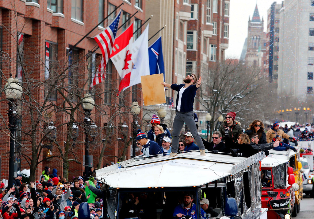 . New England Patriots receiver Julian Edelman responds to cheers from the crowd from atop a duck boat during a parade in Boston, Wednesday, Feb. 4, 2015, to honor the NFL football teams victory over the Seattle Seahawks in Super Bowl XLIX in Glendale, Ariz. (AP Photo/Winslow Townson)