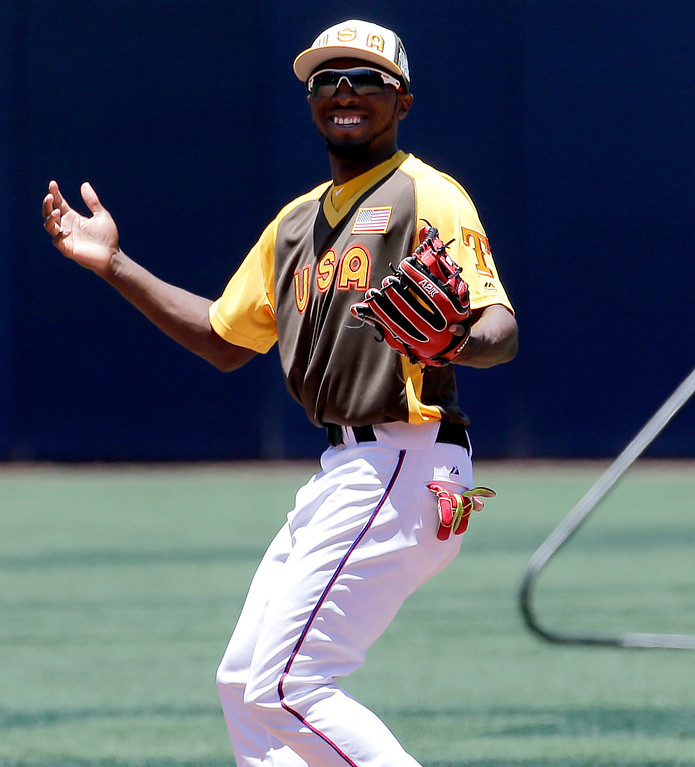 . U.S Team\'s Travis Demeritte, of the Texas Rangers, warms up prior to the All-Star Futures baseball game against the World team, Sunday, July 10, 2016, in San Diego. (AP Photo/Matt York)