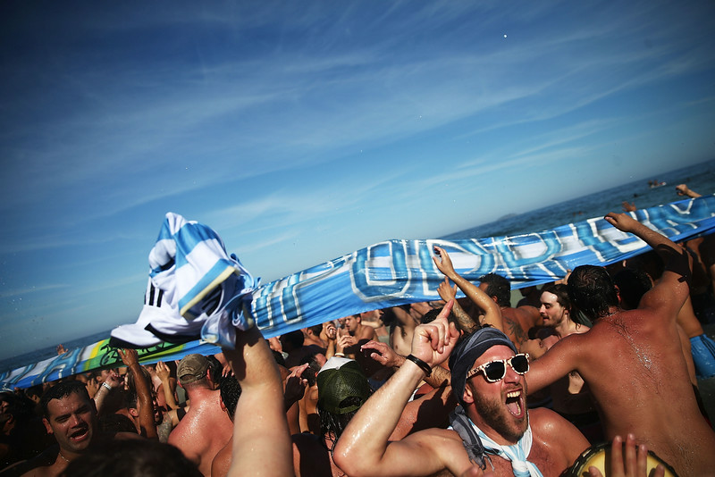 . Argentina fans celebrate during halftime before their victory over Belgium in the 2014 FIFA World Cup on Copacabana Beach on July 5, 2014 in Rio de Janeiro, Brazil. Argentina advances to the semi-finals for the first time in 24 years.  (Photo by Mario Tama/Getty Images)