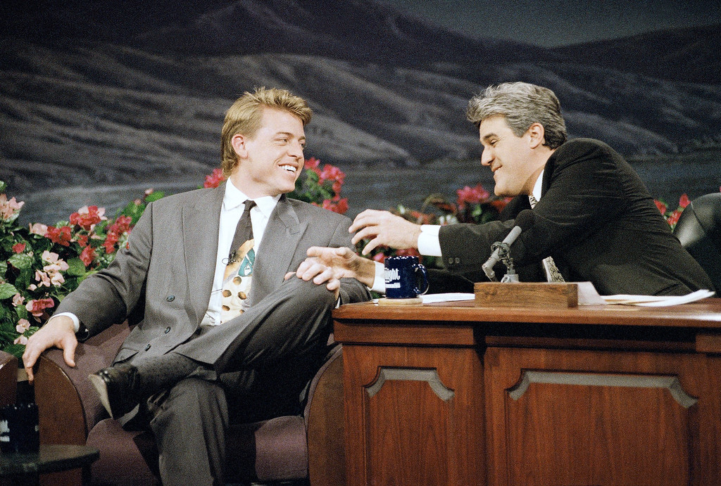 """. Dallas Cowboys\' quarterback Troy Aikman, left, the Most Valuable Player of Super Bowl XXVII, shares a laugh with \""""The Tonight Show\"""" host Jay Leno during the taping of the show in Burbank, Calif., Feb. 1, 1993. (AP Photo/Kevork Djansezian)"""