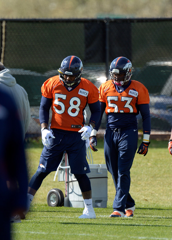. Denver Broncos outside linebacker Von Miller (58) and Denver Broncos linebacker Steven Johnson (53) run through drills during practice October 16, 2013 at Dove Valley. (Photo by John Leyba/The Denver Post)