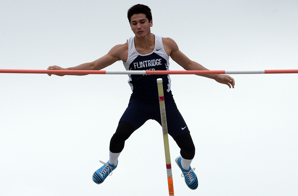 . Flintridge Prep\'s Barrett Weiss competes in the pole vault during the CIF Southern Section track and final Championships at Cerritos College in Norwalk, Calif., on Saturday, May 24, 2014.   (Keith Birmingham/Pasadena Star-News)