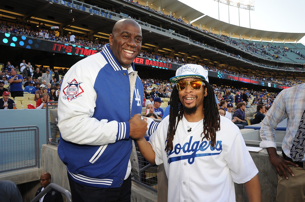 ". In this handout photo provided by the Los Angeles Dodgers, Lil Jon (R), rapper, record producer, entrepreneur and international DJ who was a member of the group Lil Jon & The East Side Boyz, threw the ceremonial first pitch during the Los Angeles Dodgers vs St. Louis Cardinals game and poses with Los Angeles Dodgers owner Earvin ""Magic\"" Johnson on May 24, 2013 in Los Angeles, California.  Lil Jon also announced the Dodgers� starting lineup.  (Photo by Jon SooHoo/Los Angeles Dodgers, LLC via Getty Images)"