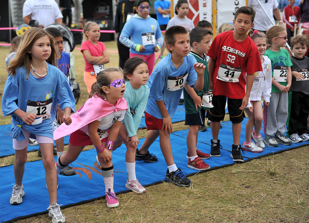 . 5/25/13 - Kids line up at the start of the 1-mile fun run during the Children Today\'s 5th Annual run/walk at Marina Green Park. The local non-profit, Children Today, is an organization that provides for families and children experiencing homelessness in Long Beach. They\'ve raised $33,184 and their final goal is $50,000. Photo by Brittany Murray / Staff Photographer