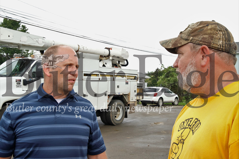 Fred McMullen(left) of the National Weather Service spent Monday assessing damage and talking to area residents  like Mike Weigle(right) before officially declaring a tornado touchdown in Parker. Seb Foltz/Butler Eagle.